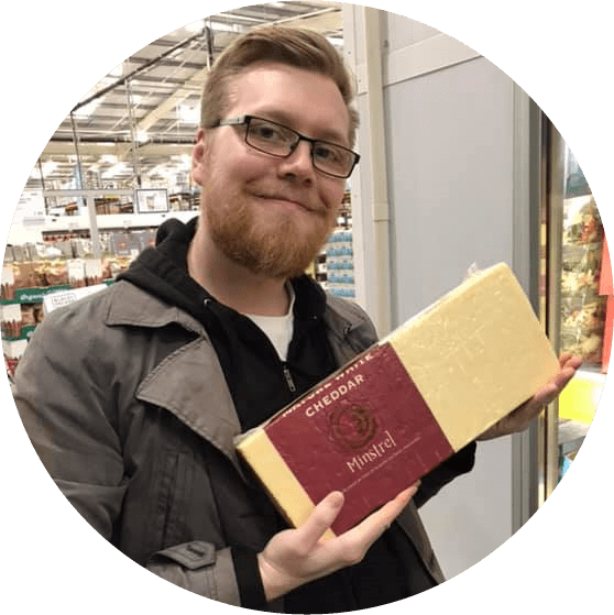 Jacob Mills holding a giant block of cheese